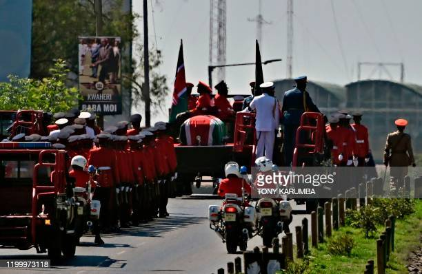 The flagdraped casket bearing the body of Kenya's former president Daniel arap Moi is carted in military honours along along Uhuru Highway on...