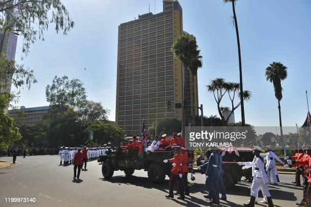 The flagdraped casket bearing the body of Kenya's former president Daniel arap Moi is carted in military honours along Kenyatta avenue on February 11...