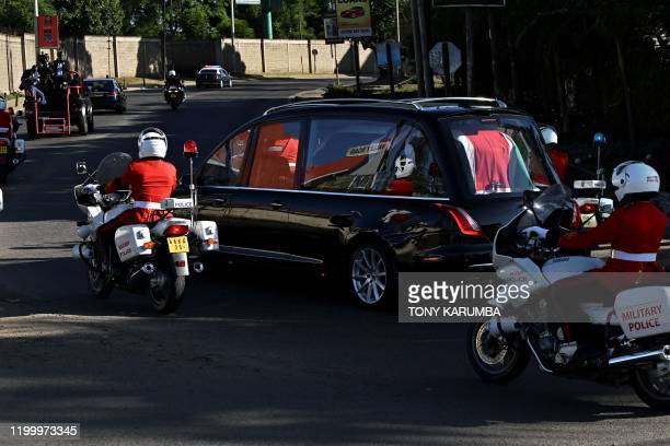 The flagdraped casket bearing the body of Kenya's former president Daniel arap Moi is seen in a hearse as it leaves the Lee Funeral Home for the...