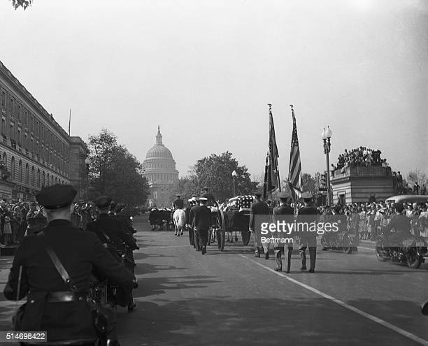The flagdraped casket bearing the body of the late Franklin D Roosevelt is rolled past thousands of mourners en route from Union Station to the White...