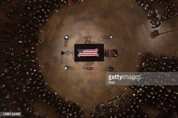 The flagdraped casket containing the remains of Former US President George H W Bush lies in state in the US Capitol Rotunda on December 03 2018 in...