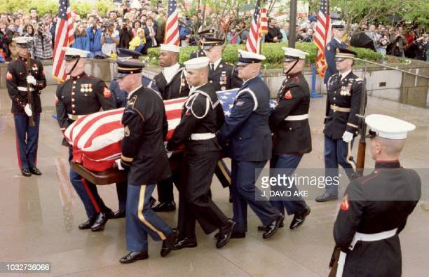 The flagdraped casket holding the body of former President Richard Nixon is carried by a military honor guard into the Richard Nixon Library 26 April...