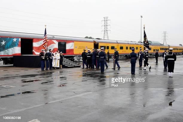 The flagdraped casket of former President George HW Bush is carried by a joint services military honor guard on December 6 2018 in Houston Texas...