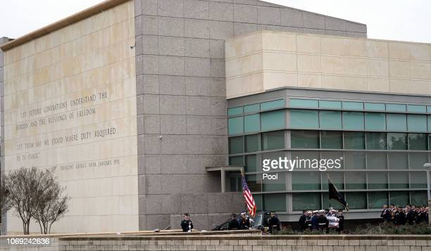 The flag-draped casket of former President George H.W. Bush is carried by a joint services military honor guard for burial at the George H.W. Bush...