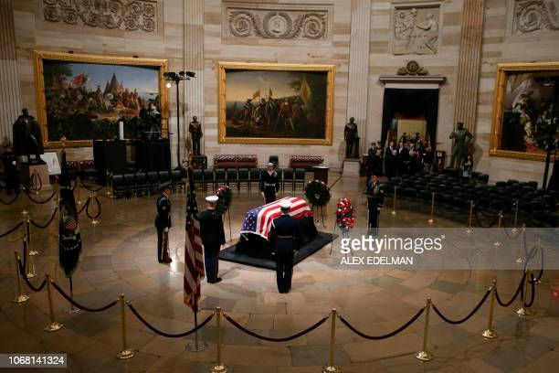 The flagdraped casket of former president George HW Bush lies in state at the Rotunda on Capitol Hill on Monday December 3 2018 in Washington DC