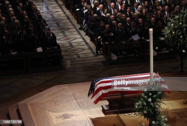 The flagdraped casket of former President George HW Bush sits on the altar at the National Cathedral during a state funeral service in Washington DC...