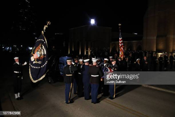 The flagdraped casket of former US President George HW Bush is carried into St Martin's Episcopal Church on December 5 2018 in Houston Texas...