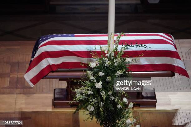 The flagdraped casket of former US President George HW Bush is viewed during the funeral service for former US President George H W Bush at the...
