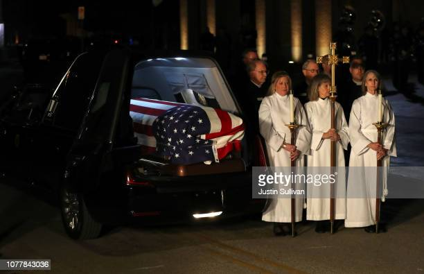 The flagdraped casket of former US President George HW Bush sits in a hearse before being carried into St Martin's Episcopal Church on December 5...