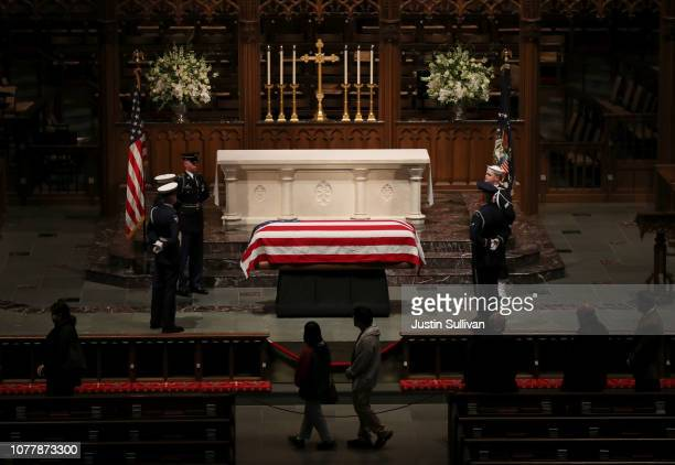 The flagdraped casket of former US President George HW Bush sits in repose inside of St Martin's Episcopal Church on December 5 2018 in Houston Texas...