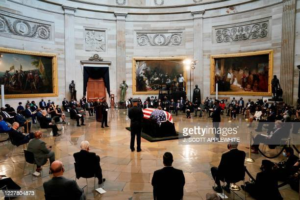 The flag-draped casket of the late Rep. John Lewis, D-GA, a key figure in the civil rights movement and a 17-term congressman from Georgia, lies in...