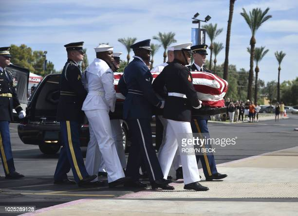 The flagdraped casket of the late US Senator John McCain arrives at the North Phoenix Baptist Church for the memorial service honoring McCain August...