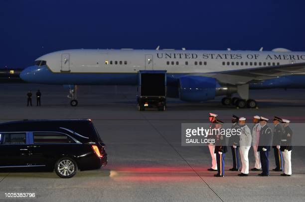 The flagdraped casket of the late US Senator John McCain Republican of Arizona arrives on a military airplane at Joint Base Andrews in Maryland...