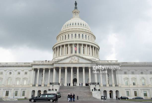 The flagdraped casket of the late US Senator John McCain Republican of Arizona arrives at the US Capitol in Washington DC August 31 prior to him...