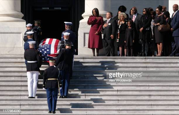 The flagdraped casket of US Rep Elijah Cummings is carried by honor guard to the Statuary Hall of the US Capitol for a memorial service as his widow...
