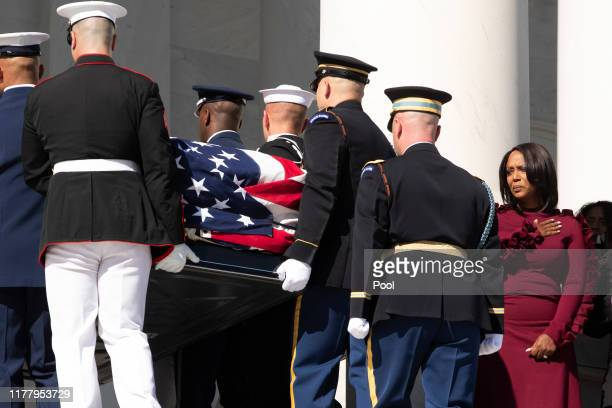 The flagdraped casket of US Rep Elijah Cummings is carried up the East Front steps as his widow Maya Rockeymoore Cummings and family look on October...