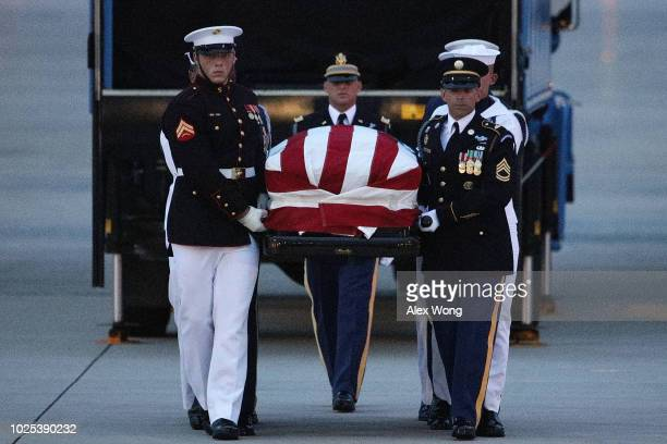 The flagdraped casket of US Sen John McCain is unloaded from an aircraft upon its arrival August 30 2018 at Joint Base Andrews Maryland The late...