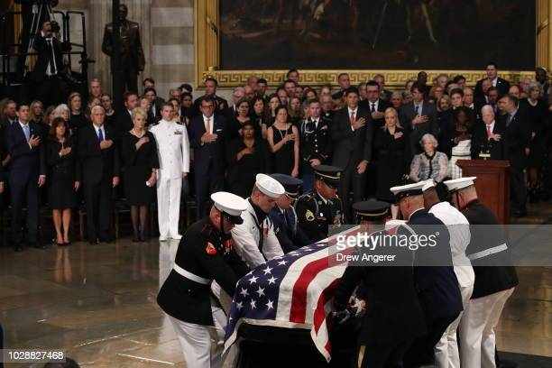 The flagdraped casket of US Senator John McCain arrives inside the Rotunda of the US Capitol August 31 2018 in Washington DC August 31 2018 in...