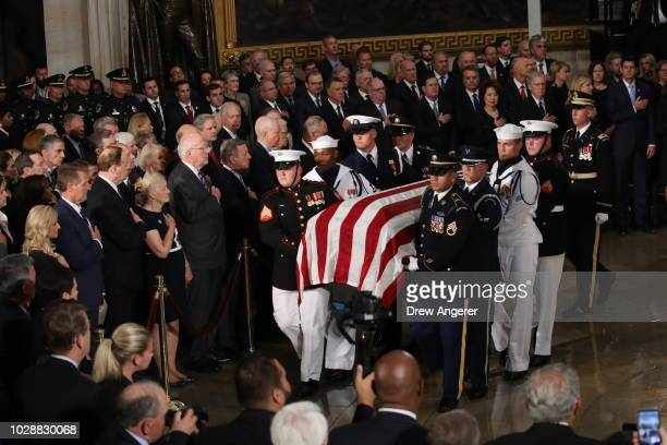 The flagdraped casket of US Senator John McCain arrives inside the Rotunda of the US Capitol August 31 2018 in Washington DC The late senator died...