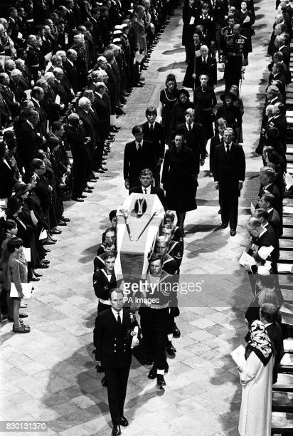 The flagdraped coffin of Earl Mountbatten is carried out of Westminster Abbey London by a Royal Navy bearer party following the Earl's funeral...
