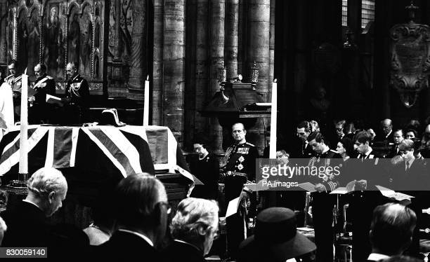 The flagdraped coffin of Lord Mountbatten rests on a catafalque during the funeral service in Westminster Abbey Royal mourners are Queen Elizabeth II...