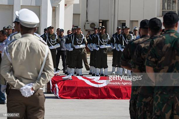 The flagdraped coffins of the two police officers killed by an armed group on Thursday are displayed in front of members of security forces during a...