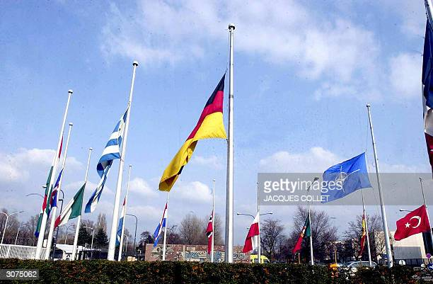 The flags are set down at half mast in front of the NATO headquarters in Brussels11 March 2004 in sign of mourning for the victims of the...