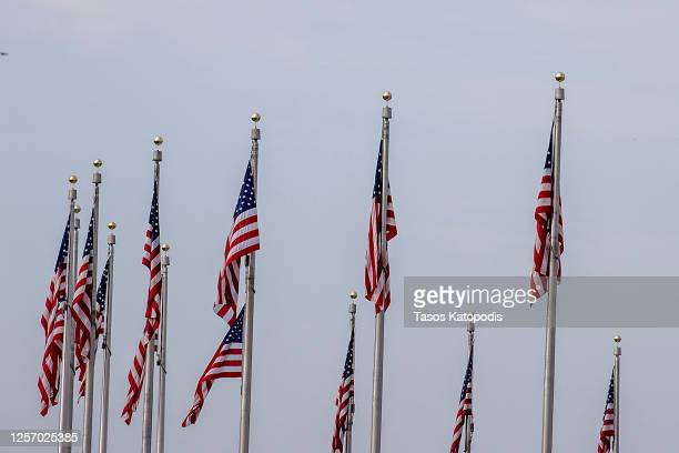 The flags at Washington Monument are at full staff on July 19, 2020 in Washington, DC. Rep. John Lewis, died at 80 years old, was an icon leader in...