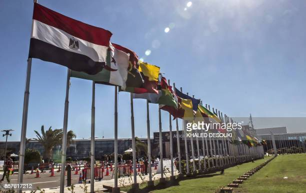 The flags of African nations flutter at the entrance of the Africa 2017 Forum in Egypt's Red Sea resort of Sharm elSheikh on December 7 as the...