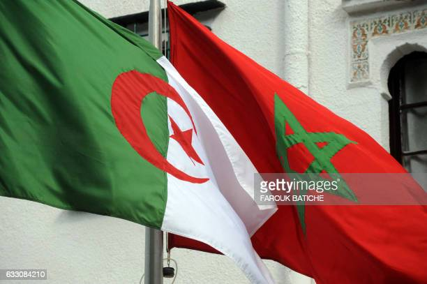The flags of Algeria and Morocco flutter as Algerian president greets Moroccan Foreign Minister on January 24 2012 in Algiers Moroccan Foreign...