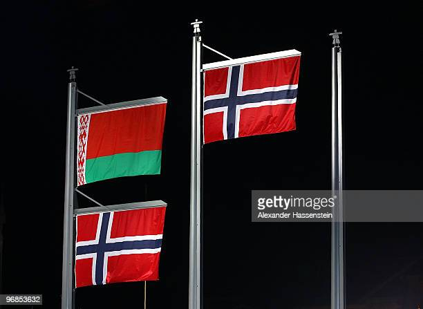 The flags of Belarus and Norway are raised together as their were two silver medals awarded to Ole Einar Bjoerndalen of Norway and Sergey Novikov of...