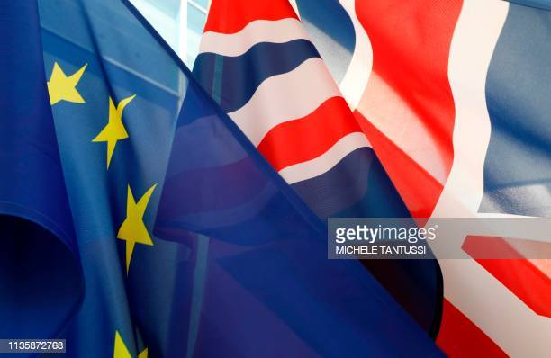 TOPSHOT The flags of Britain and the European Union flutter in front of the Chancellery in Berlin where the British Prime Minister was expected on...