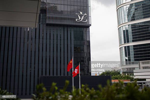 The flags of China left and Hong Kong fly outside the Legislative Council building in the Admiralty district of Hong Kong China on Saturday July 4...