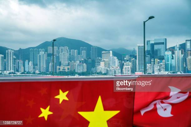 The flags of China, left, and the Hong Kong Special Administrative Region against the city's skyline ahead of the anniversary of Hong Kong's return...