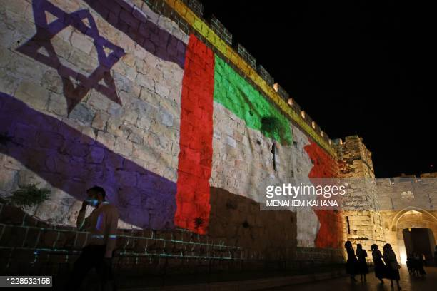 The flags of Israel, United Arab Emirates, and Bahrain are projected on the ramparts of Jerusalem's Old City on September 15, 2020 in a show of...