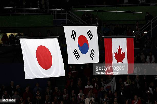 The flags of Japan South Korea and Canada during the medal ceremony for the Ladies Figure Skating on day 14 of the 2010 Vancouver Winter Olympics at...