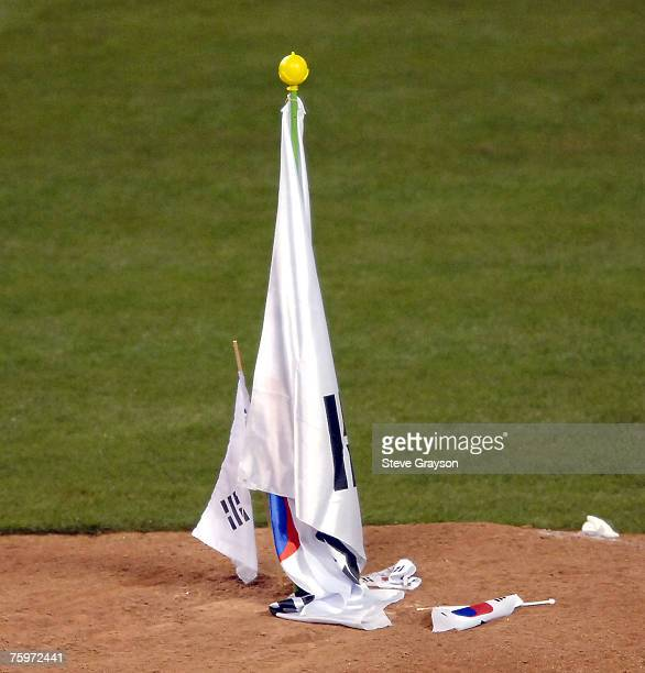 The Flags of Korea are planted on the picther's mound by Jae Weong Seo after their 21 victory over Japan in the 2006 World Baseball Classic at Angel...