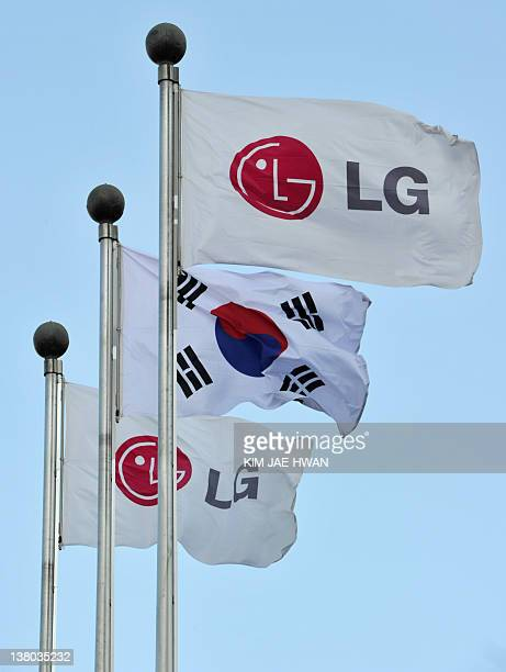 The flags of South Korea's LG Electronics flutter outside the company's head office in Seoul on February 1 2012 LG the world's thirdlargest mobile...