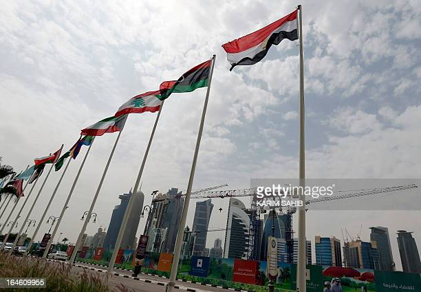 The flags of the 22 arab countries flutter outside the hotel that will host the 24th summit of the Arab League on March 25 2013 in the Qatari capital...