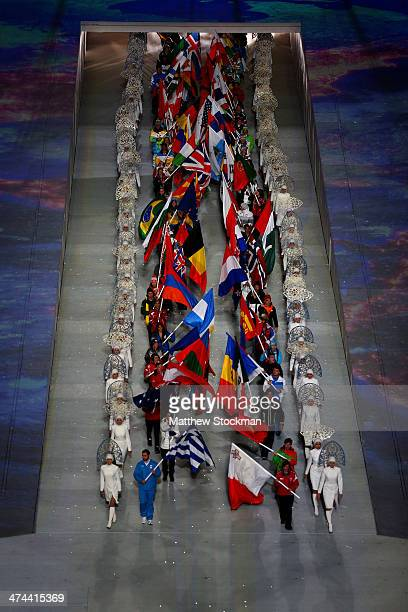 The flags of the competiting nations senter the arean during the 2014 Sochi Winter Olympics Closing Ceremony at Fisht Olympic Stadium on February 23...