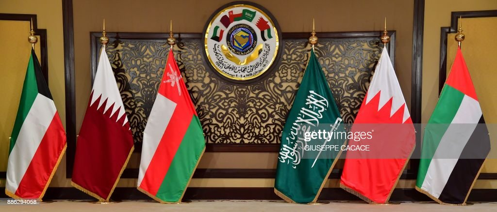 The flags of the countries attending the Gulf Cooperation Council (GCC) summit are displayed at Bayan palace in Kuwait City on December 5, 2017. The Gulf Cooperation Council, which launches its annual summit today in Kuwait amid its deepest ever internal crisis, comprises six Arab monarchies who sit on a third of the world's oil. A political and economic union, the GCC comprises Saudi Arabia, the United Arab Emirates, Kuwait, Qatar, Oman and Bahrain. Dominated by Riyadh, it is a major regional counterweight to rival Iran. CACACE