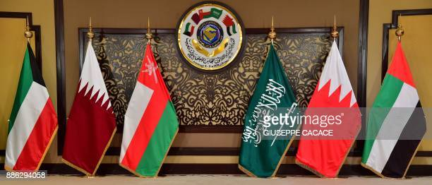 The flags of the countries attending the Gulf Cooperation Council summit are displayed at Bayan palace in Kuwait City on December 5, 2017. The Gulf...