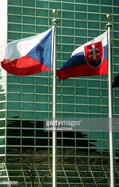 The flags of the Czech Republic and the Slovak Republic fly outside the United Nations New York NY after the two new republics were admitted to the...