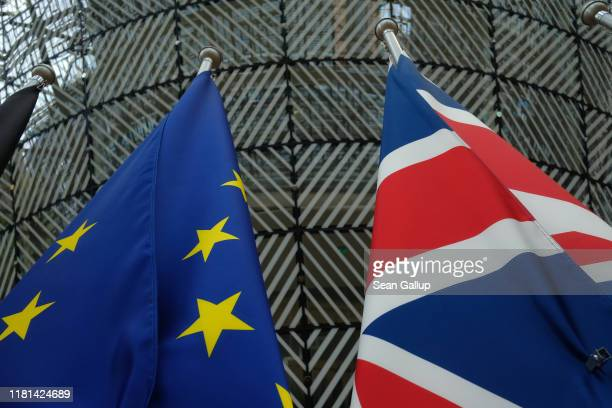 The flags of the European Union and the United Kingdom hang one day prior to a summit of European Union leaders at the European Council on October...