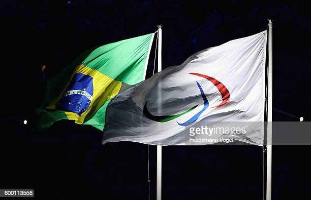 The flags of the International Paralympic Committee and of Brazil fly during the Opening Ceremony of the Rio 2016 Paralympic Games at Maracana...