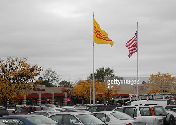 The flags of the United States and the former South Vietnam fly outside the Eden Center shopping complex in the Washington suburb of Falls Church on...