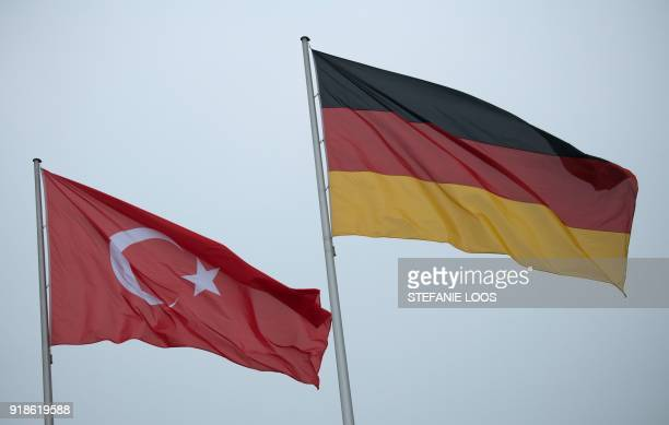 The flags of Turkey and Germany flutter in front of the Chancellery in Berlin where the Turkish Prime Minister is expected for a visit on February 15...