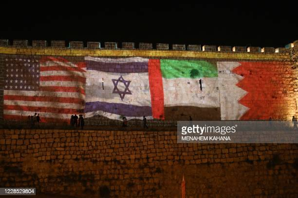 The flags of US, Israel, United Arab Emirates, and Bahrain are projected on the ramparts of Jerusalem's Old City on September 15, 2020 in a show of...