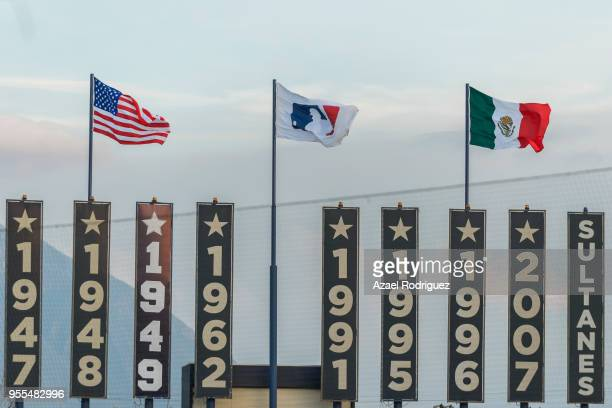 The flags of USA MLB and Mexico wave at the end of the MLB game between the San Diego Padres and the Los Angeles Dodgers at Estadio de Beisbol...