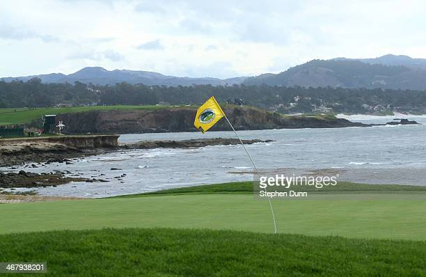 The flagstick on the 18th hole bends in the wind during a morning weather delay in the third round of the ATT Pebble Beach National ProAm at the...